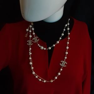 Authentic Chanel  extra long pearl necklace